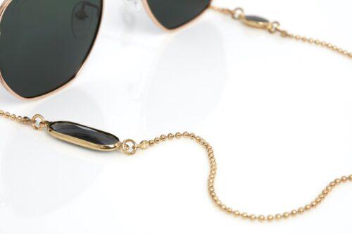 Crystal C goud met zwart kristal